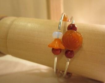 Memory wire gemstone bracelet in orange hues