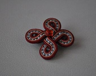 Brooch soutache Burgundy woven pattern.