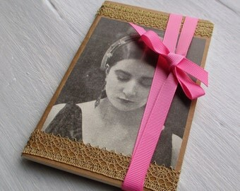 Book paper kraft, retro, vintage portrait sepia women of the roaring twenties, customized lace lurex gold and Pink Ribbon tie.