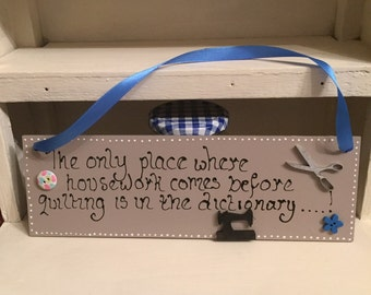 "A 10"" x 3"" wooden plack with blue ribbon"