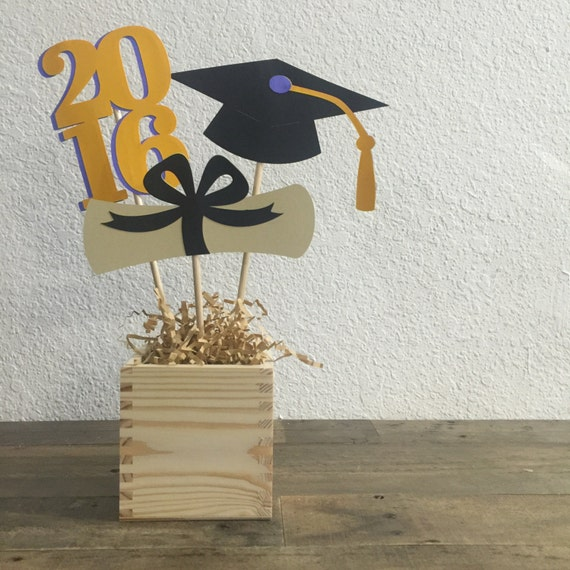 Items similar to graduation table centerpiece sticks blue