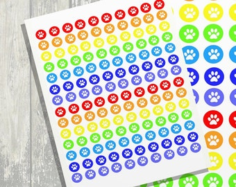 Printable round stickers with a paw in rainbow colors