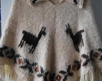1970's ladies woolen poncho with Llamas and fringe