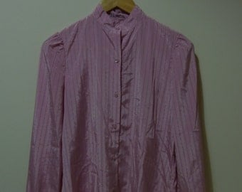 Blouse pink with stripes and bright details, name of former owner. Made in U.S.A. Vintage. Size S-M