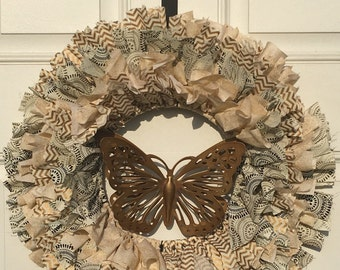 Beige and gold shag wreath with double winged gold metal butterfly in the center 18 inch