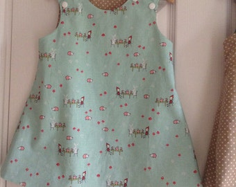 Cute bunnies and hedgehogs tea party reversible pinny