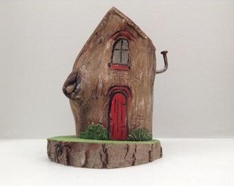 174 - little wood fairy house, red door, green grass on branch slice base. Greytimberwolfcrafts