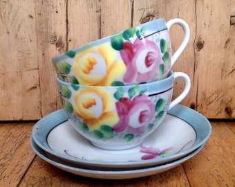 Set of two matching Japanese tea cups and saucers, vintage tea cups