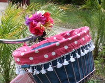 Spunky and fun pink and blue polka dot bicycle basket liner.