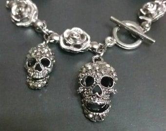 Gunmetal Rose gunmetal rose bracelet with rhinestone skulls