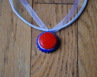Red, white, and blue bottle cap pendant ribbon necklace