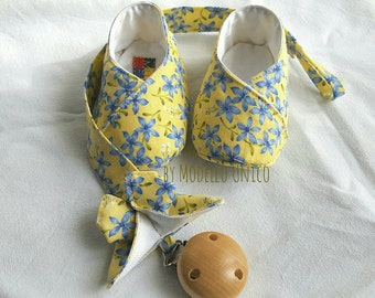 baby booties and wears yellow cotton with blue floral pacifier matched