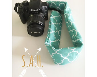 Teal quatrefoil camera strap cover