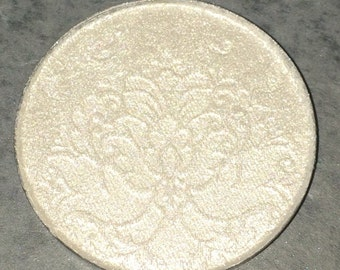 Swan Princess pressed highlighter -  Cool toned icy white with high shine. Suitable for lighter complexions