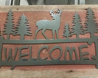 Metal Welcome sign mounted to barn wood
