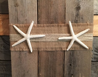 Starfish and burlap on pallet wood