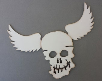 Winged Skull. White painted wood.