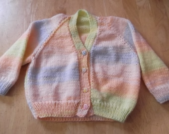 Hand knitted cardigan with paw buttons