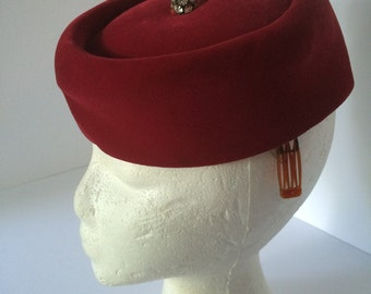 Red pill box hat