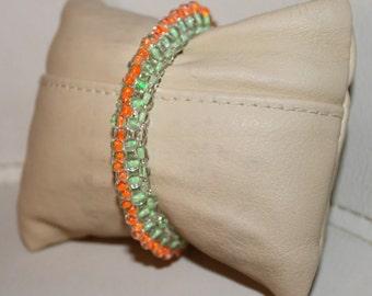 Green & orange-beaded handmade bracelet; beadweaving