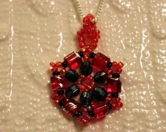 Red & black beaded handmade pendant; beadweaving