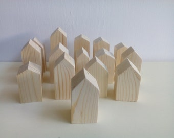Wooden houses. Wooden village. Raw wood.