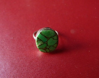 silver with a green stone ring