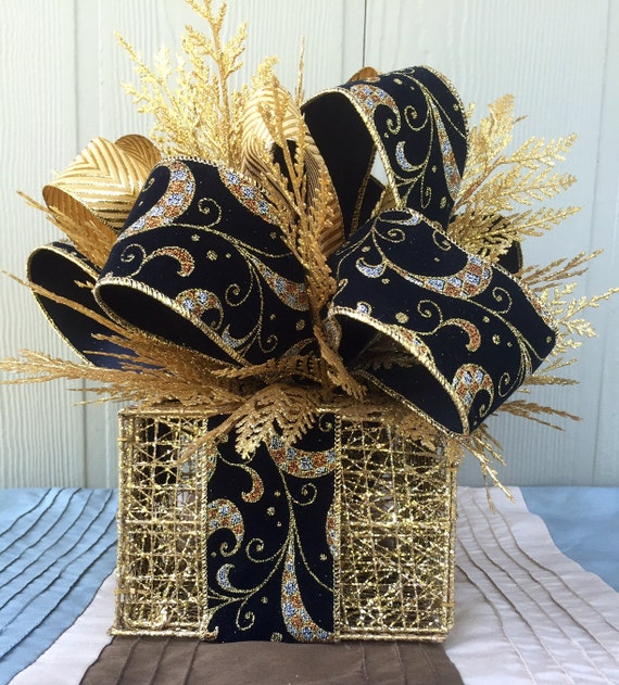 Black and gold centerpiece by spacecandybylj on etsy