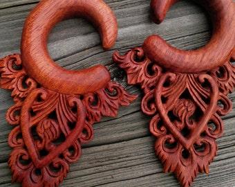 Bloodwood hanging design, carved on both sides.