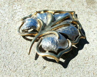 Gold and silver leaf brooch