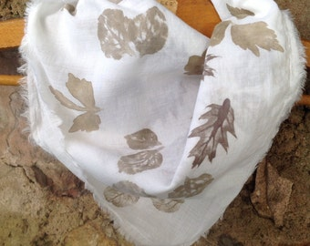 Scarf prints of plants on white cotton voile.