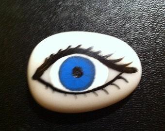 Eye painting on stone magnet