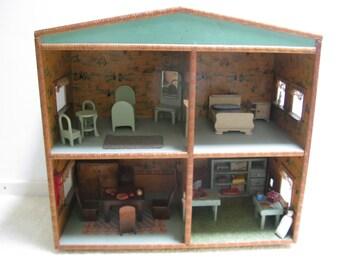 Original antique Dutch Doll House, with Dutch scenes on the muur...ca. 1930!