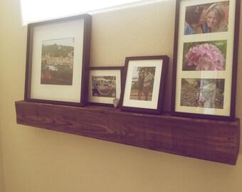 Large floating shelf made with reclaimed barnwood