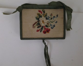 Antique needle book with petitpoint on paper canvas covers