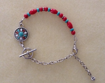 Assymetrical red and turquoise bracelet