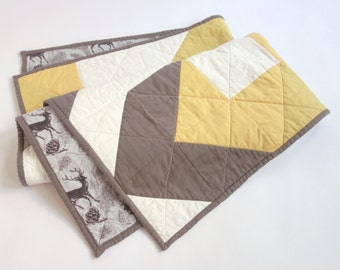 Grey + gold baby quilt with woodland flannel backing. Modern patchwork design on front.