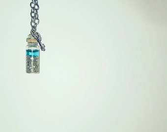 Frozen Treasure glass bottle pendant