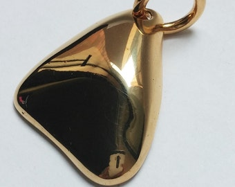 Large, geometric and handmade pendant