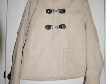 Tan coat with faux fur collar