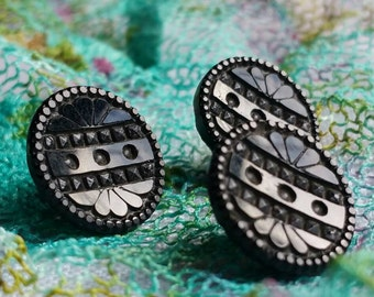 Antique black glass buttons.   Set of 3.  1.3 cm  Metal shanks.  Lovely pattern.