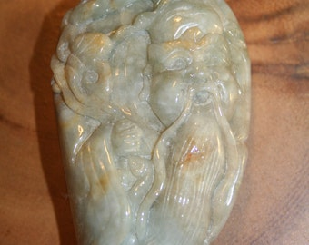 """Very fine jadeite carving of an """"immortal"""" in the form of a worry stone"""