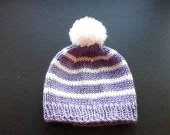 Children's hand knit striped beanie.