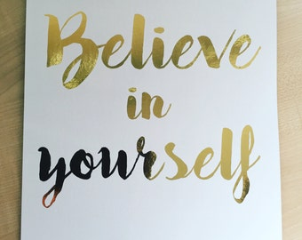 "Ready to frame A4 inspirational quote ""Believe in yourself"" gold foil print on white paper"
