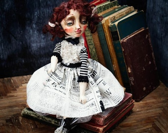 Maggie is a book loving girl paper clay art doll by Danita Art that wold love to live on a library and read as soon as she is adopted by you