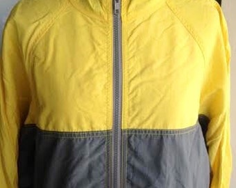 Vintage O'neill vintage 1980's surfer girl/guy  light weight wind breaker jacket. size small