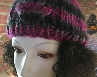 Purple, hand knitted hat with cable accent