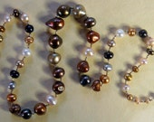Hand knotted multi color fresh water pearls and Bali sterling silver beaded necklace