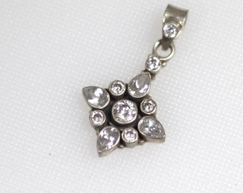 Sterling silver flower clear faceted cubic zirconia pendant