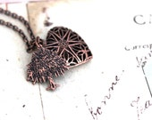 tree. heart locket necklace. filigree in copper ox with floral background jewelry